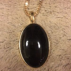 Jewelry - Gold tone necklace with black stone